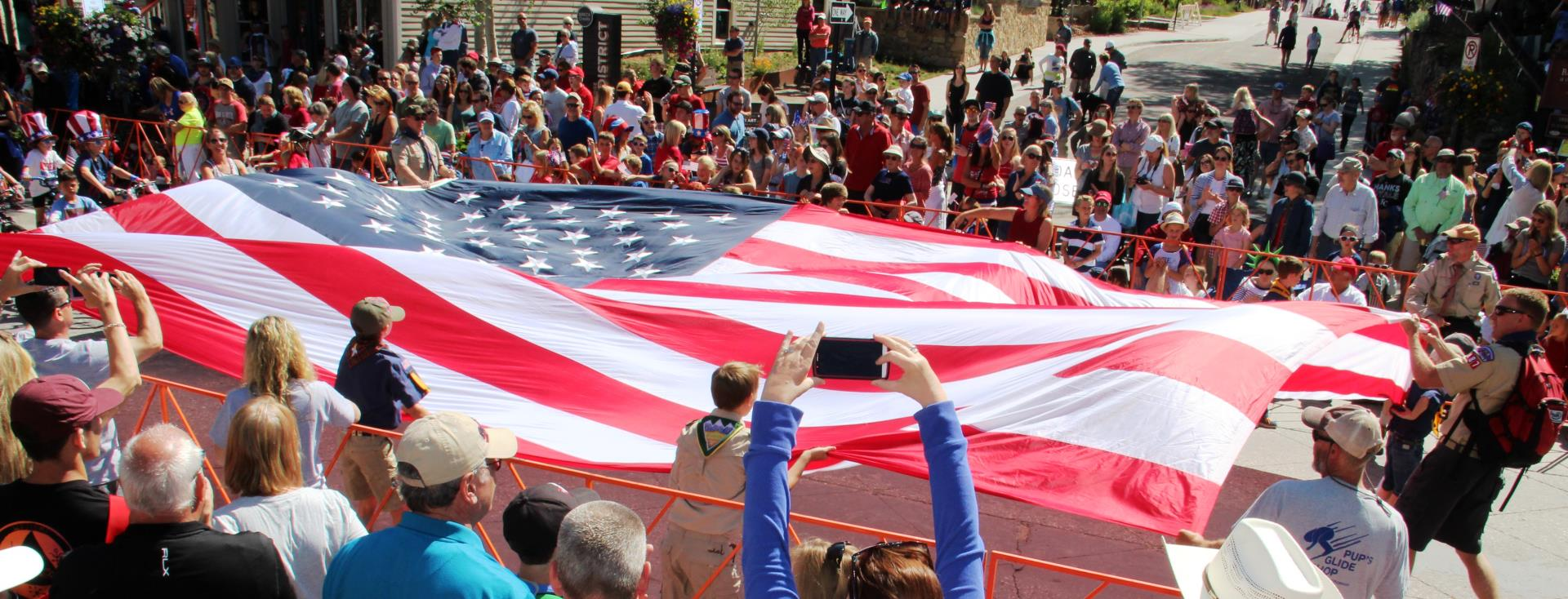 USA American flag carried by Boy Scouts in July 4th parade