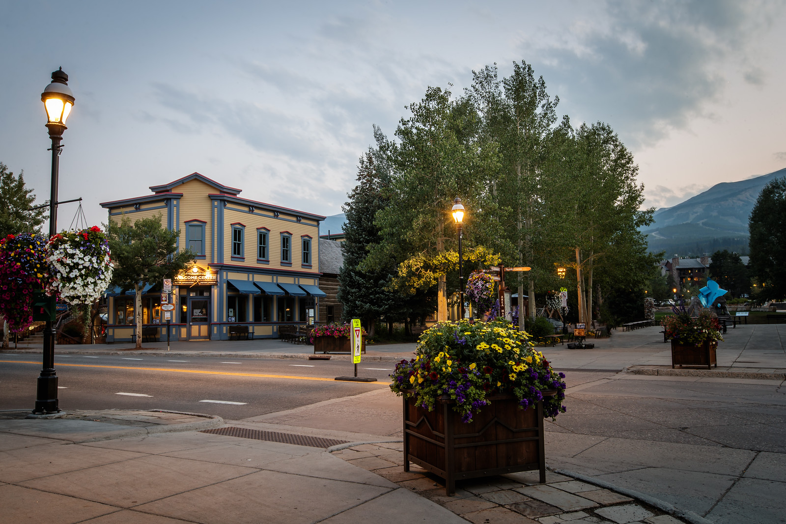 shot from the corner of main street with the Welcome Center and mountains in the background