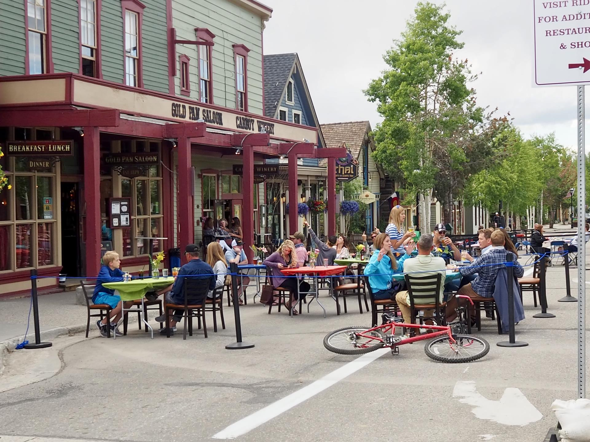 People eat lunch outside on Main Street